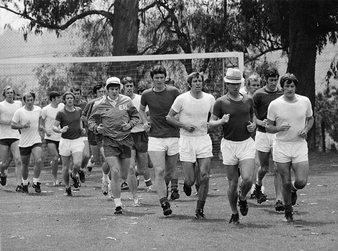 The England World Cup football team in training, Mexico City, May 1970. Wearing hats are players Emlyn Hughes (left) and Bobby Charlton