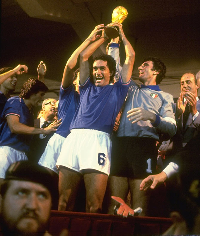 The Italy players hold the trophy aloft after winning the 1982 World Cup final against West Germany in 1982