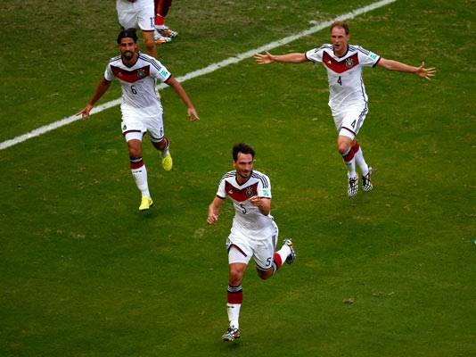 Mats Hummels of Germany (No 5) celebrates with teammates Sami Khedira (left) and Benedikt Hoewedes (right) after scoring his team's second goal against Portugal