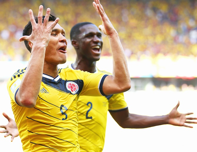 Teofilo Gutierrez of Colombia,left, celebrates scoring his team's second goal   with Cristian Zapata against Greece at Estadio Mineirao on June 14