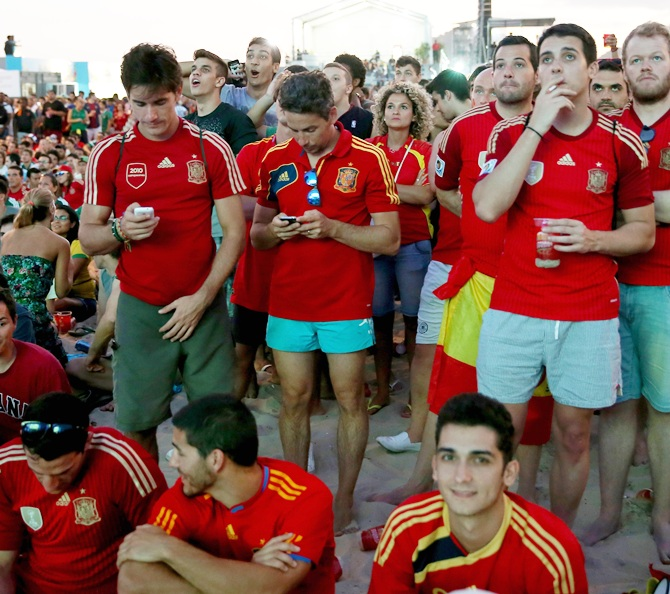 Fans of the Spanish team watch