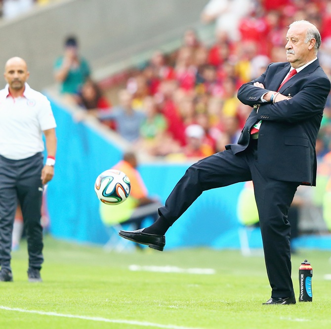 Head coach Vicente del Bosque of Spain kicks the ball on the sideline