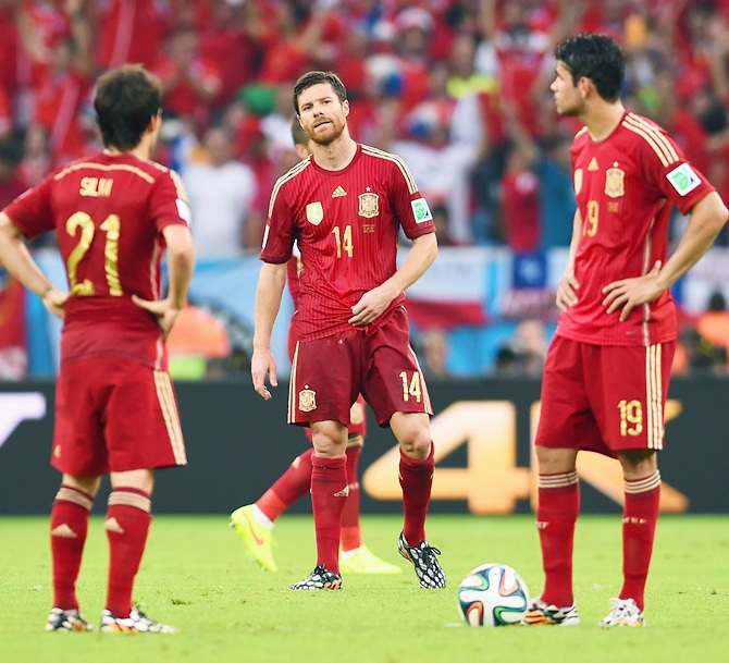 Xabi Alonso of Spain looks on as his teammates wait to kickoff