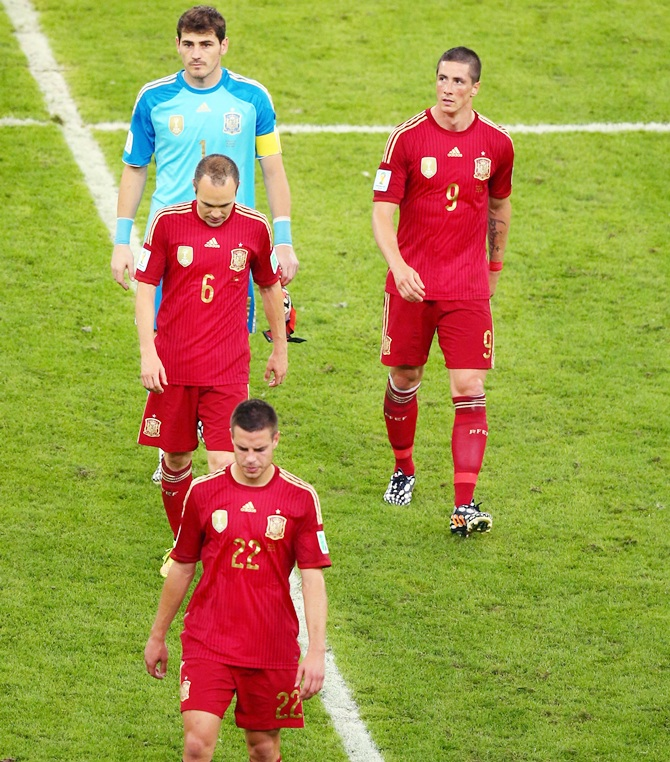Cesar Azpilicueta, Andres Iniesta,Iker Casillas and Fernando Torres of Spain walk off the pitch after a 2-0 defeat to Chile