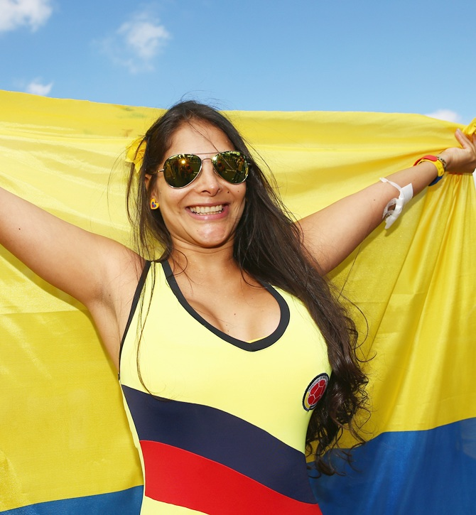 A Colombia fan holds a flag prior to the 2014 FIFA World Cup Brazil Group C match against Ivory Coast
