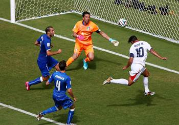 Bryan Ruiz of Costa Rica scores his team's first goal on a header past Gianluigi Buffon of Italy