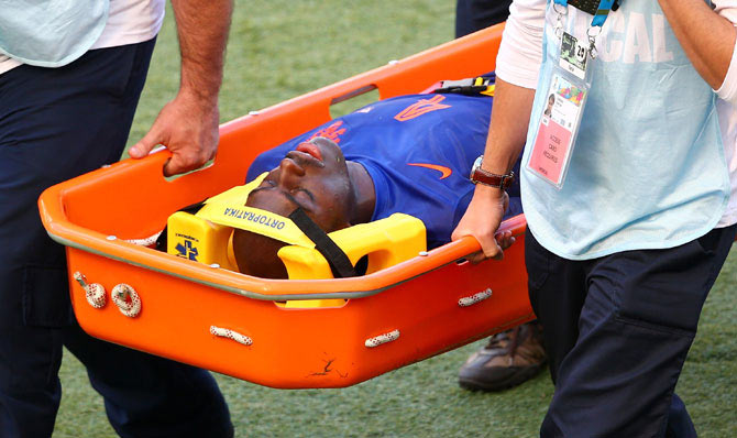 Bruno Martins Indi of the Netherlands is stretchered off the field