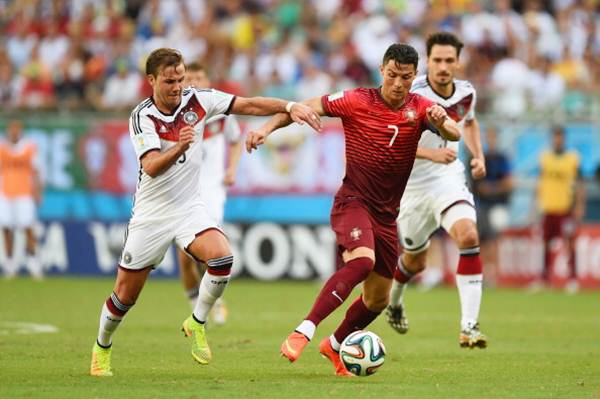Cristiano Ronaldo breaks away from two German defenders during the World Cup Group G match