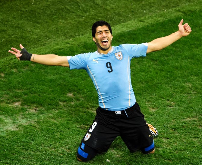Luis Suarez of Uruguay celebrates after scoring the second goal against England.