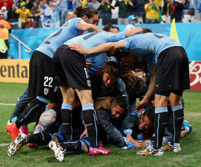Uruguay's players celebrate after Luis Suarez scored the second goal.