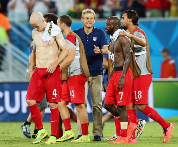 United States coach Jurgen Klinsmann with his players after the victory over Ghana
