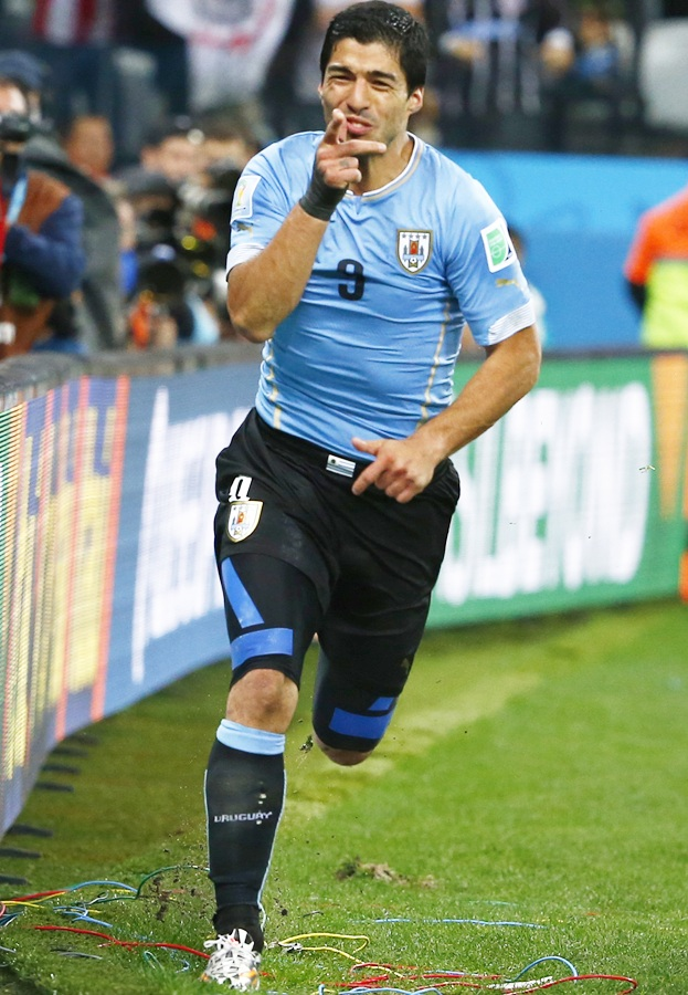 Uruguay's Luis Suarez celebrates after scoring his second goal