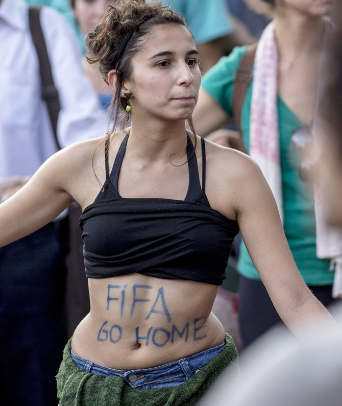 A protester participates in a demonstration against the 2014 World Cup