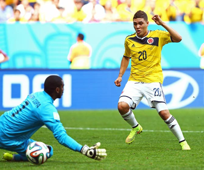 Juan Quintero of Colombia scores his team's second goal past Ivory Coast goalkeeper Boubacar Barry