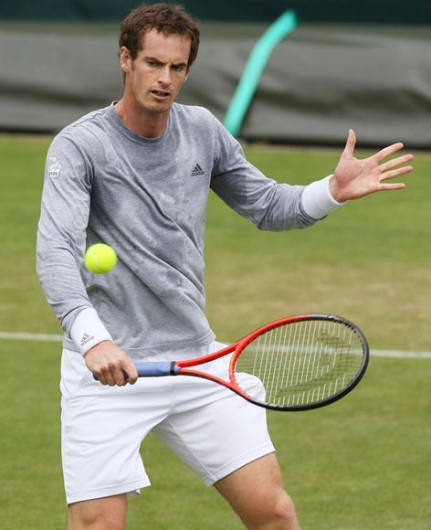 Andy Murray of Great Britain plays a backhand during a practice session