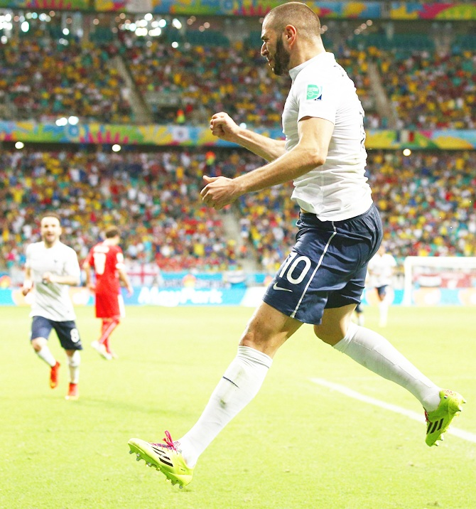 Karim Benzema of France celebrates scoring his team's fourth goal