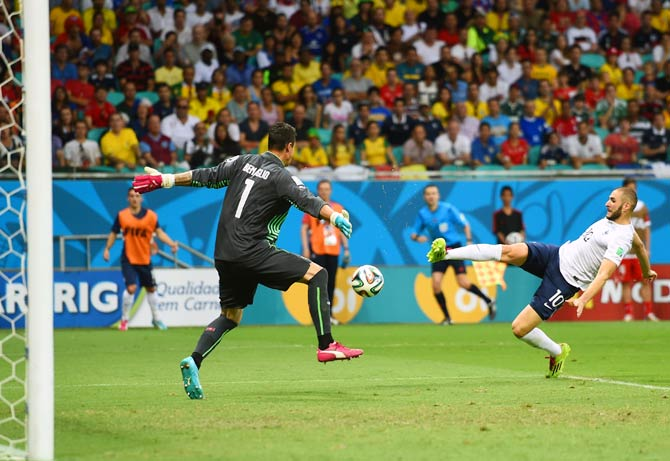 Karim Benzema (right) scores the fourth goal for France past Switzerland goalkeeper Diego Benaglio