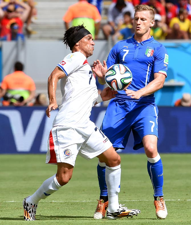 Costa Rica's Bolanos (left) and Ignazio Abate of Italy compete for the ball