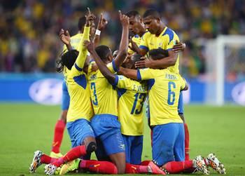 Enner Valencia (No 13) of Ecuador celebrates with teammates after scoring his team's second goal against Honduras