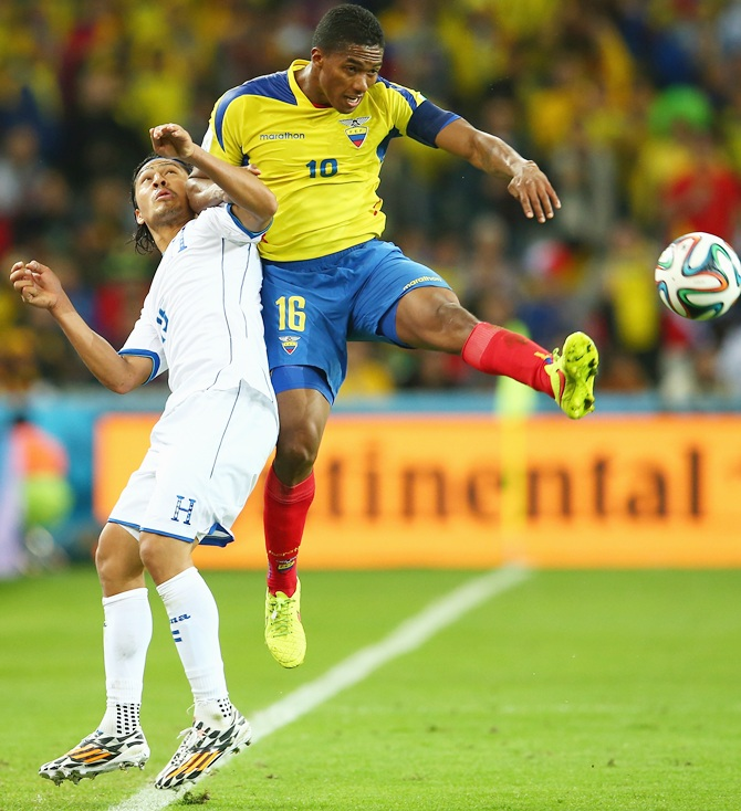 Antonio Valencia of Ecuador competes for the ball with Roger Espinoza of Honduras