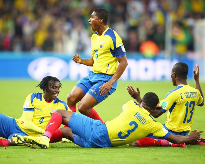 Enner Valencia of Ecuador, right, celebrates after scoring his team's second   goal with Juan Carlos Paredes, left,  Antonio Valencia, second left, and Frickson Erazo