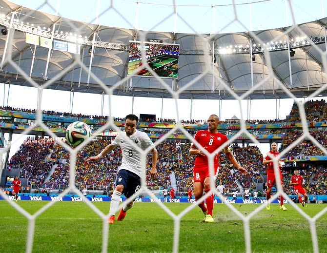 Mathieu Valbuena of France scores his team's third goal