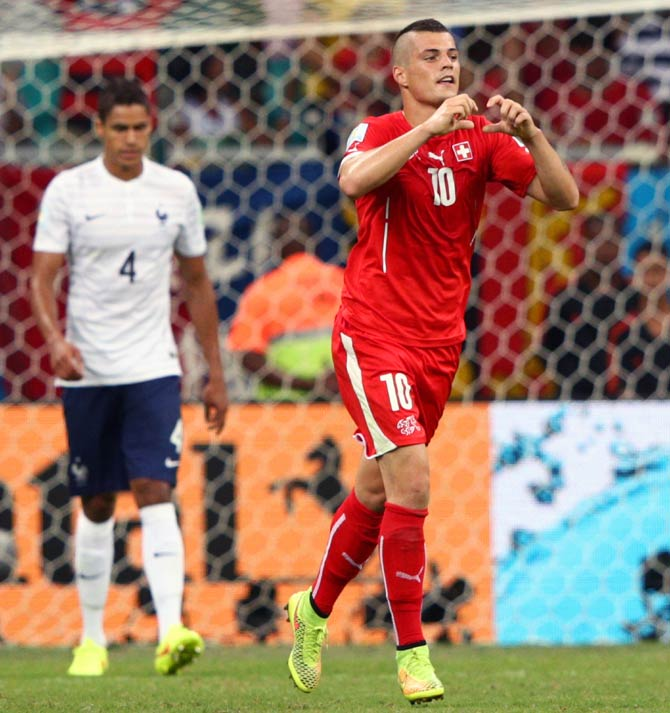 Granit Xhaka of Switzerland celebrates scoring his team's second goal