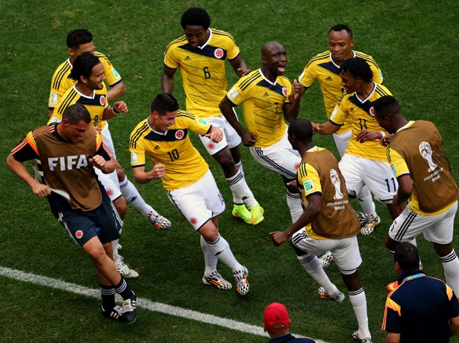 Colombia's players celebrate after James Rodriguez (No 10) scored the opening goal against Ivory Coast