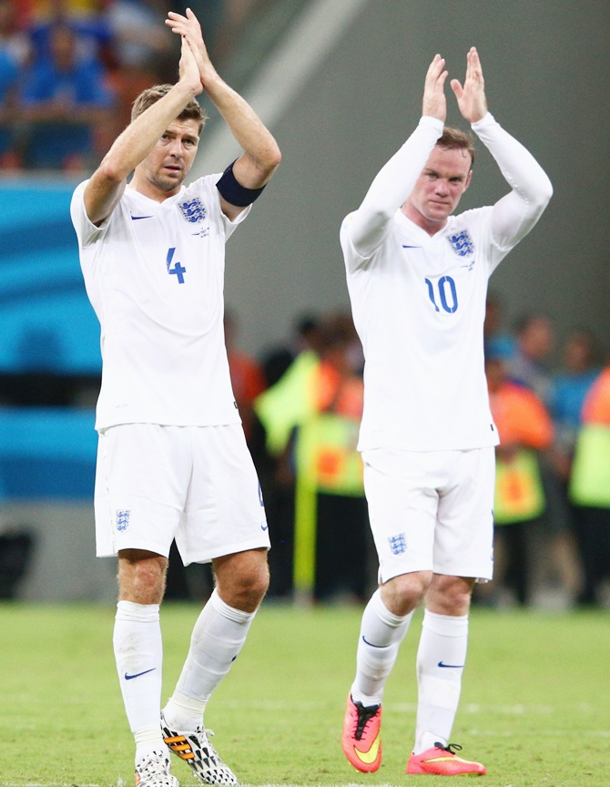 Steven Gerrard of England and Wayne Rooney acknowledge the fans after being defeated by Italy 2-1