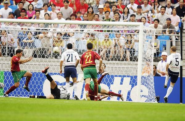 John O'Brien of the United States (far right) scores the opening goal against Portugal during the first half of the Group D, World Cup Group Stage match at the Suwon World Cup Stadium, Suwon, South Korea on June 5, 2002.