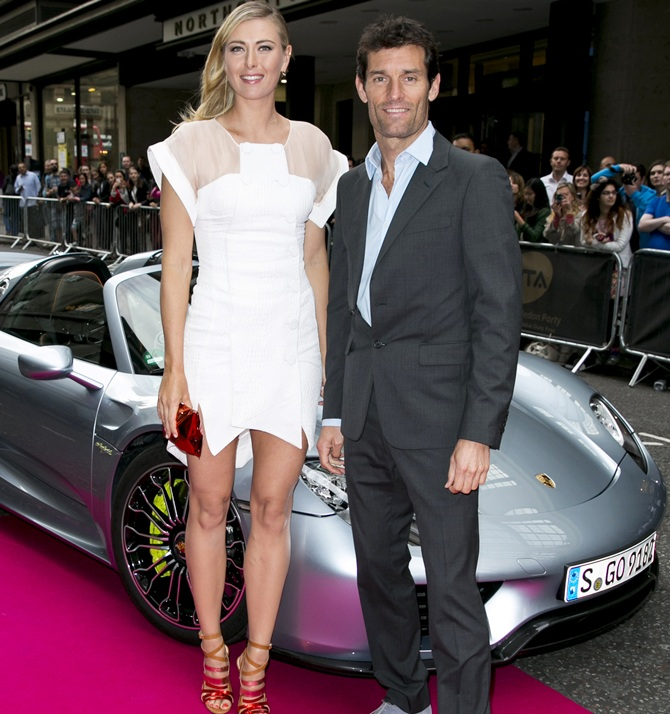 Maria Sharapova and Porsche Works driver Mark Webber arrive with a Porsche 918 Spyder super sportscar for the WTA pre-Wimbledon party