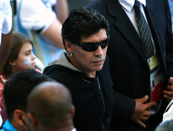 Diego Maradona watches the action from the stands