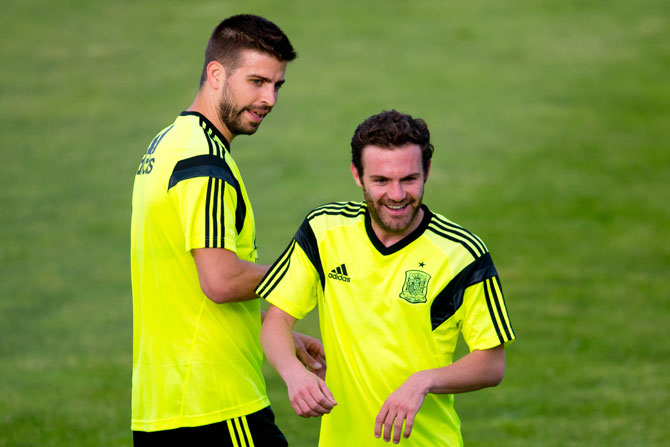 Gerard Pique and Juan Mata of Spain