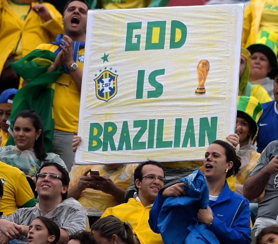 Brazilian fans cheer their team