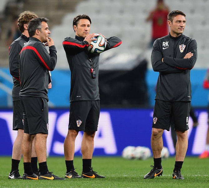 Croatia coach Niko Kovac with the team's assistant coach Robert Kovac (right) at a training session