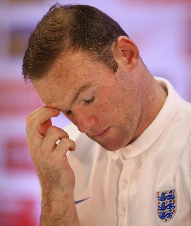 Wayne Rooney faces the media in a press conference