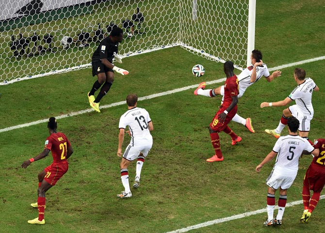 Miroslav Klose scores Germany's second goal past Ghana goalkeeper Fatawu Dauda