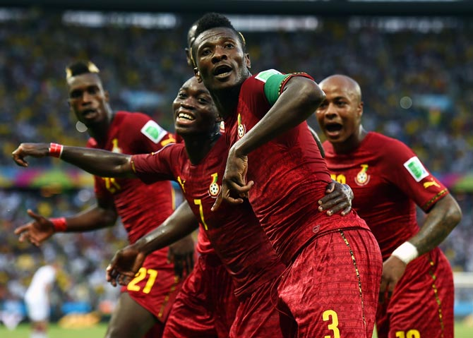 Asamoah Gyan (front) celebrates scoring Ghana's second goal with team mates