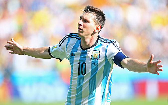 Lionel Messi of Argentina celebrates scoring his team's first goal against Iran on Saturday