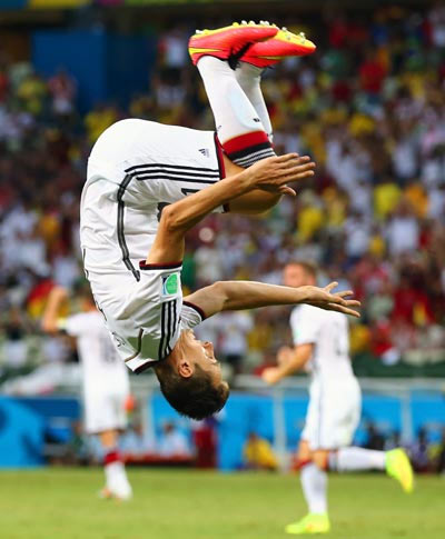 Miroslav Klose celebrates after scoring the record-equalling second goal