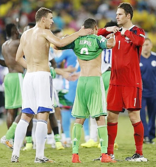 Bosnia's Edin Dzeko (left), Asmir Begovic and Nigeria's Peter Odemwingie (centre) exchange jerseys at the end of their match
