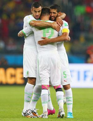Algerian team celebrates the win over South Korea