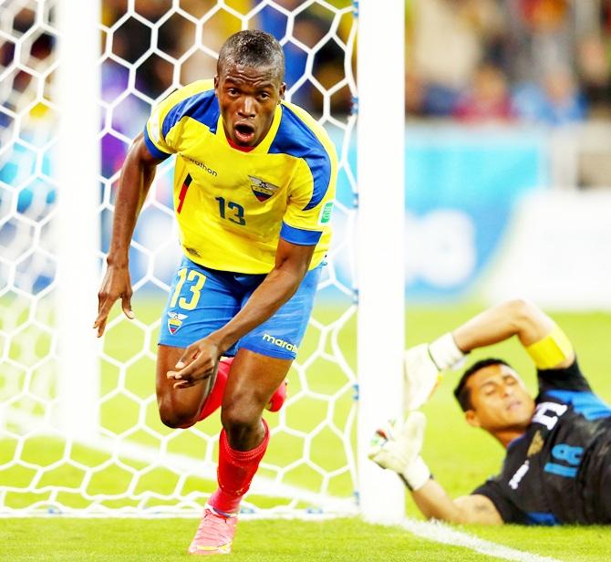 Enner Valencia of Ecuador celebrates scoring his team's first goal past Noel Valladares of Honduras