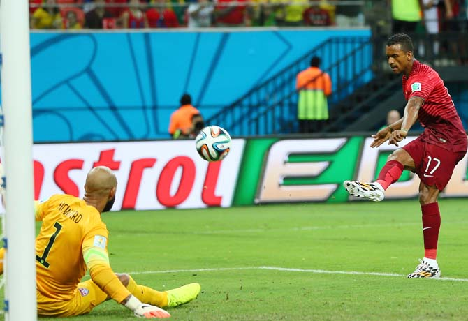 Nani of Portugal scores his team's first goal past goalkeeper Tim Howard of the United States
