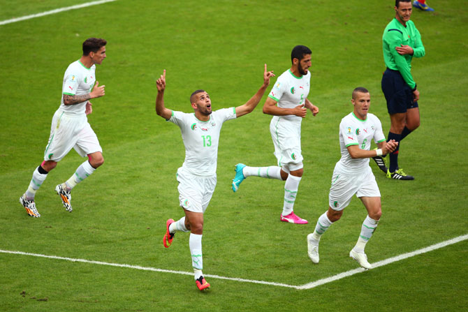 Islam Slimani of Algeria celebrates scoring his team's first goal during the Group H against South Korea
