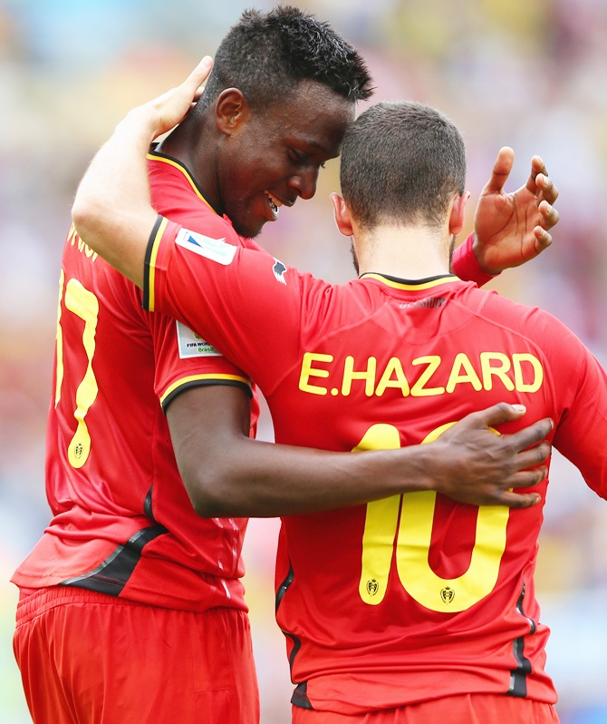 Divock Origi of Belgium celebrates scoring with Eden Hazard