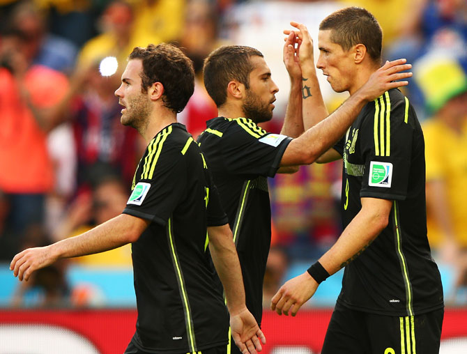 Fernando Torres of Spain (right) celebrates scoring his team's second goal with teammates