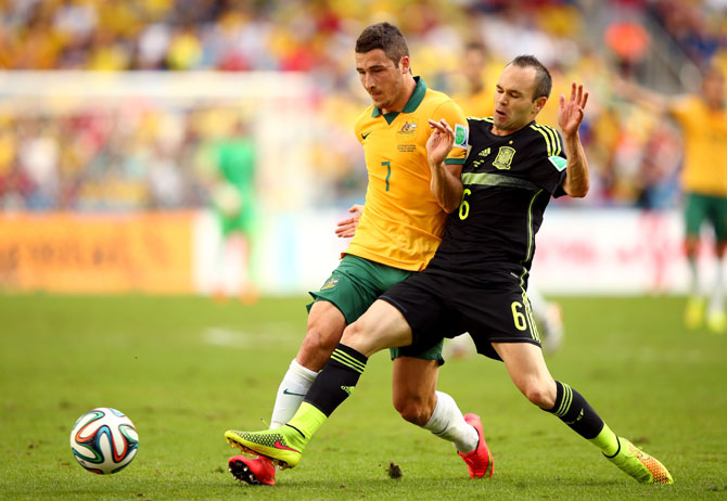 Mathew Leckie of Australia is challenged by Andres Iniesta of Spain