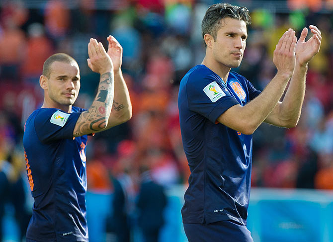 Wesley Sneijder and Robin Van Persie of the Netherlands acknowledge the fans