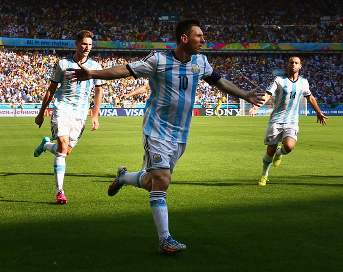 Lionel Messi of Argentina celebrates scoring his team's first goal against Iran